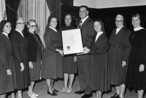 Mayor presenting proclamation to Sisters