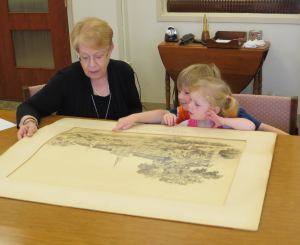 Bryan and Anna Russell examine the architect's drawing of the Villa St. Michael Baltimore with Provincial Archivist Dee Gallo