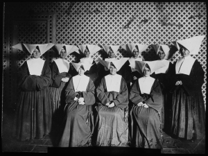 Sisters who served in the Loyola Unit. Standing, left to right: Sisters Valeria Dorn, Agatha Muldoon, DeSales Loftus, Mary David Ingram, Angela Drendel, Lucia Dolan, Florence Means. Seated, left to right: Sisters Catherine Coleman, Chrysostum Moynahan, Marianna Flynn (used with permission of Daughters of Charity Archives)