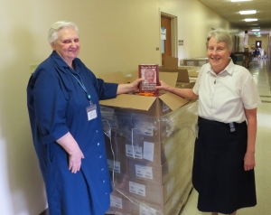 Sister Marie Poole (left), editor-in-chief of the Vincentian Translation Project, with editorial assistant Sister Ann Mary Dougherty and Volume 14 of the Correspondence, Conferences, and Documents of Vincent de Paul.