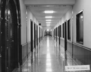 A distinctive feature of the building was its long corridors, such as this one looking down F wing toward the Basilica.