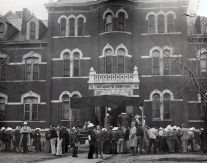 Workers gather outside the old St. Mary's Hospital prior to the start of the move